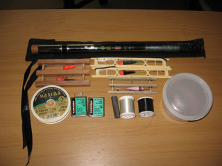Rod, tackles, spare hooks and hook link material, weighs and bait box for a days fishing